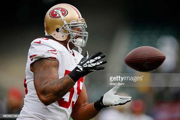 Linebacker Ahmad Brooks of the San Francisco 49ers catches a pass against the Oakland Raiders on December 7 2014 at Oco Coliseum in Oakland...