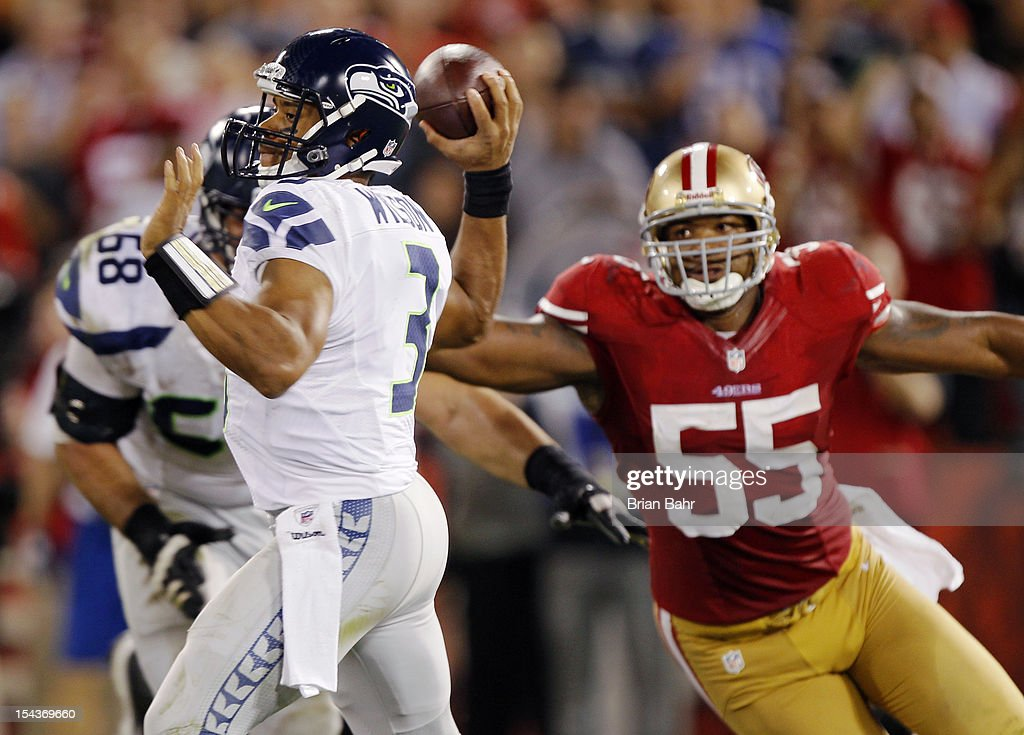 Linebacker <a gi-track='captionPersonalityLinkClicked' href=/galleries/search?phrase=Ahmad+Brooks&family=editorial&specificpeople=2326499 ng-click='$event.stopPropagation()'>Ahmad Brooks</a> #55 of the San Francisco 49ers rushes quarterback <a gi-track='captionPersonalityLinkClicked' href=/galleries/search?phrase=Russell+Wilson+-+American+Football+Quarterback&family=editorial&specificpeople=2292912 ng-click='$event.stopPropagation()'>Russell Wilson</a> #3 of the Seattle Seahawks in the fourth quarter on October 18, 2012 at Candlestick Park in San Francisco, California. The 49ers won 13-6.