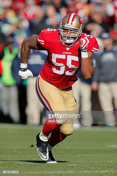 Linebacker Ahmad Brooks of the San Francisco 49ers rushes the Seattle Seahawks in the first quarter on December 8 2013 at Candlestick Park in San...