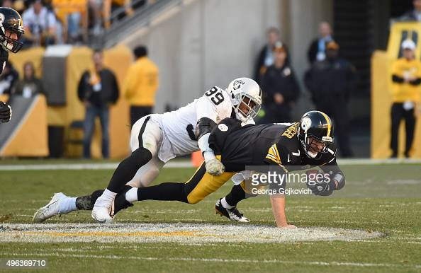 Linebacker Aldon Smith of the Oakland Raiders sacks quarterback Ben Roethlisberger of the Pittsburgh Steelers during a game at Heinz Field on...