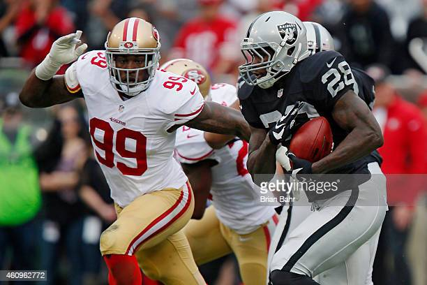 Linebacker Aldon Smith of the San Francisco 49ers chases after running back Latavius Murray of the Oakland Raiders at the end of the first quarter on...