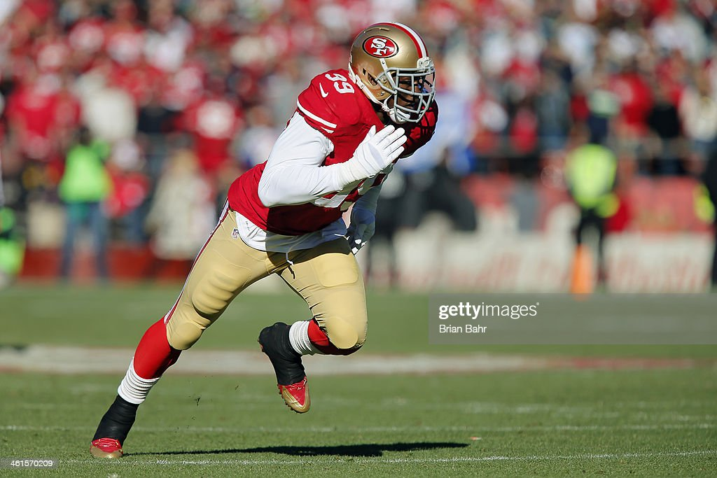 Linebacker <a gi-track='captionPersonalityLinkClicked' href=/galleries/search?phrase=Aldon+Smith&family=editorial&specificpeople=6522981 ng-click='$event.stopPropagation()'>Aldon Smith</a> #99 of the San Francisco 49ers rushes the Seattle Seahawks in the first quarter on December 8, 2013 at Candlestick Park in San Francisco, California. The 49ers won 19-17.