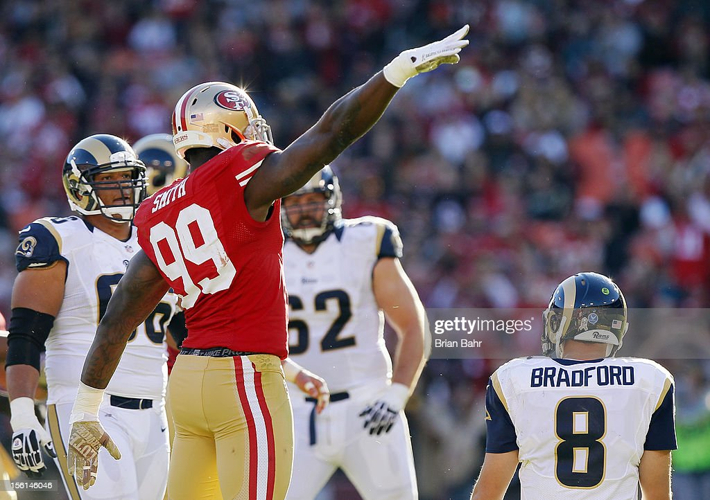 Linebacker <a gi-track='captionPersonalityLinkClicked' href=/galleries/search?phrase=Aldon+Smith&family=editorial&specificpeople=6522981 ng-click='$event.stopPropagation()'>Aldon Smith</a> #99 of the San Francisco 49ers salutes the crowd on Veteran's Day after sacking quarterback <a gi-track='captionPersonalityLinkClicked' href=/galleries/search?phrase=Sam+Bradford&family=editorial&specificpeople=4489292 ng-click='$event.stopPropagation()'>Sam Bradford</a> #8 of St. Louis Rams in the second quarter on November 11, 2012 at Candlestick Park in San Francisco, California. The teams tied 24-24 in overtime.