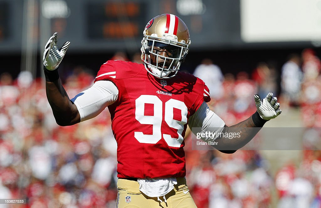 Linebacker Aldon Smith #99 of the San Francisco 49ers tries to amp up the crowd before a snap by the Buffalo Bills in the first quarter on October 7, 2012 at Candlestick Park in San Francisco, California.