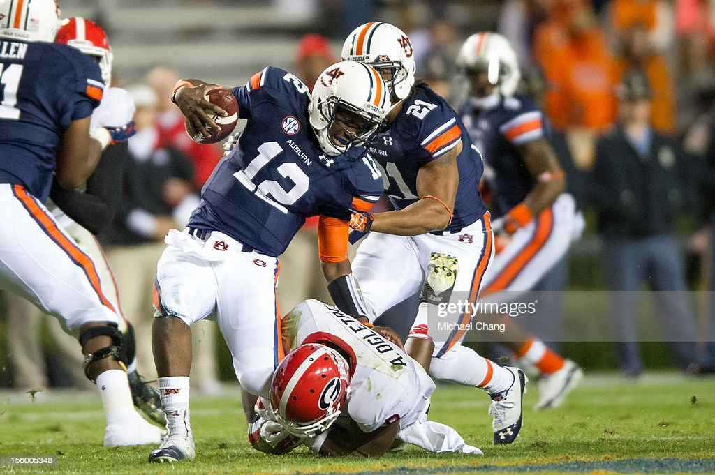 Linebacker Alec Ogletree #9 of the Georgia Bulldogs sacks quarterback <a gi-track='captionPersonalityLinkClicked' href=/galleries/search?phrase=Jonathan+Wallace+-+American+Football+Quarterback&family=editorial&specificpeople=15195972 ng-click='$event.stopPropagation()'>Jonathan Wallace</a> #12 of the Auburn Tigers during the second half of play on November 10, 2012 at Jordan-Hare Stadium in Auburn, Alabama. Georgia defeated Auburn 38-0 and clinched the SEC East division.