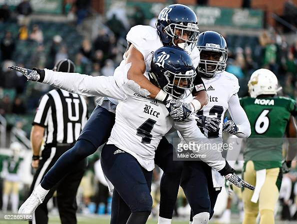 Linebacker Alex Lyons of the Rice Owls carries cornerback VJ Banks in celebration after a gamewinning stop against the Charlotte 49ers at...