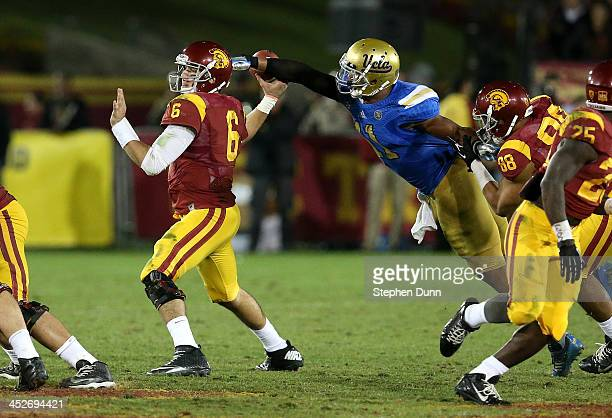 Linebacker Anthony Barr of the UCLA Bruins strips the ball from quarterback Cody Kessler of the USC Trojans for a fumble and a turnover in the fourth...