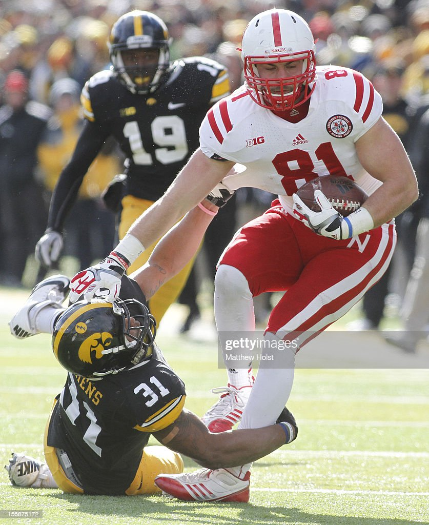 Linebacker Anthony Hitchens #31 of the Iowa Hawkeyes makes a tackle during the second quarter on Ben Cotton #81 of the Nebraska Cornhuskers on November 23, 2012 at Kinnick Stadium in Iowa City, Iowa. Iowa lead Nebraska 7-3 at the half.