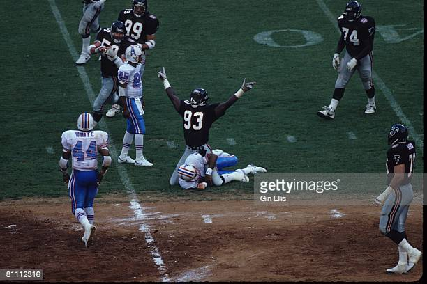 Linebacker Aundray Bruce of the Atlanta Falcons celebrates after sacking quarterback Warren Moon of the Houston Oilers in Atlanta FultonCounty...