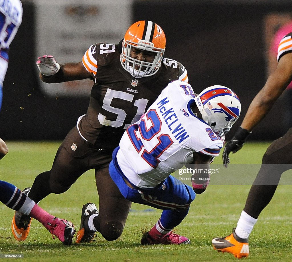 Linebacker Barkevious Mingo of the Cleveland Browns tackles defensive back Leodis McKelvin on a punt during a game against the Buffalo Bills at...