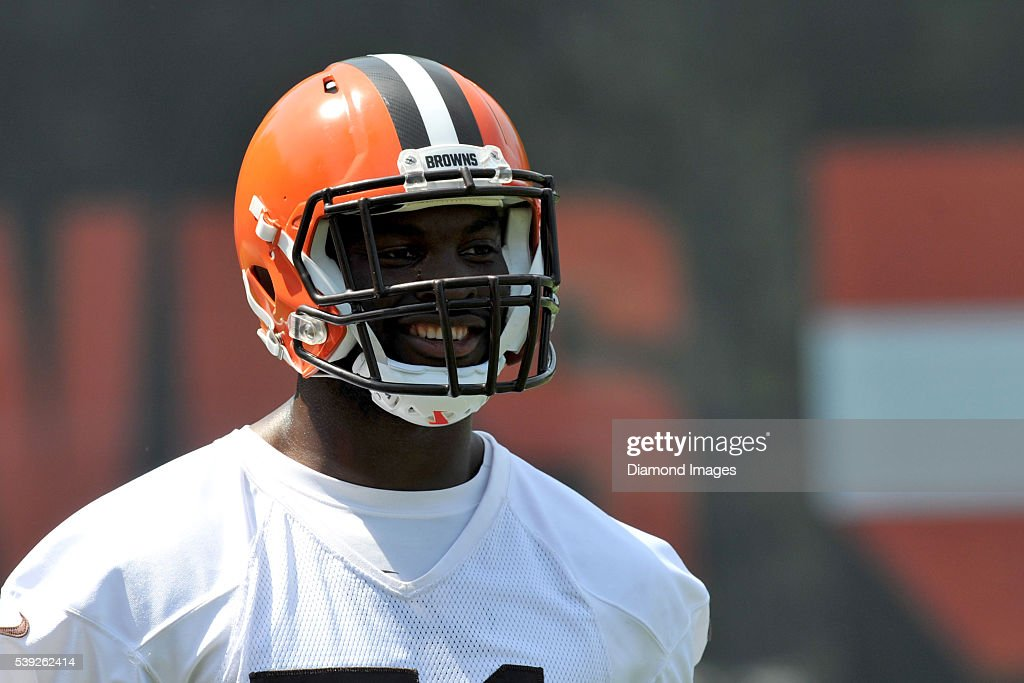 Linebacker Barkevious Mingo of the Cleveland Browns walks onto the field during an OTA on June 1 2016 at the Cleveland Browns training facility in...