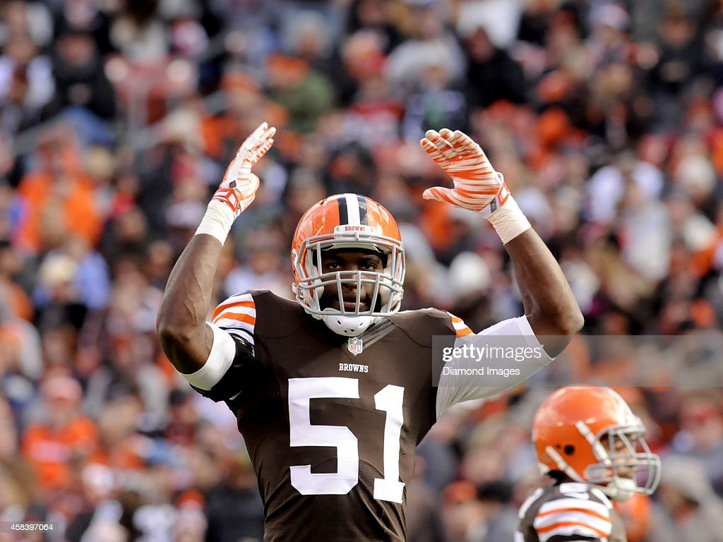 Linebacker Barkevious Mingo of the Cleveland Browns waves his arms toward the crowd indicating to raise the volume during a game against the Tampa...