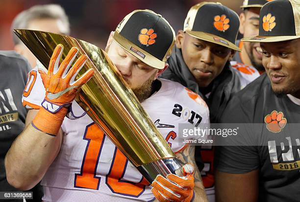 Linebacker Ben Boulware of the Clemson Tigers celebrates with the College Football Playoff National Championship Trophy after defeating the Alabama...