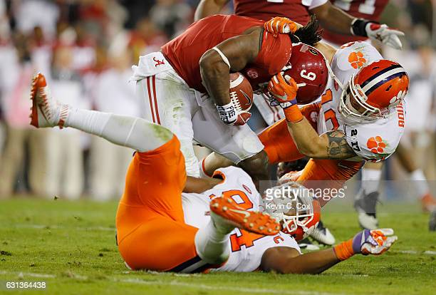 Linebacker Ben Boulware of the Clemson Tigers tackles running back Bo Scarbrough of the Alabama Crimson Tide during the first half of the 2017...