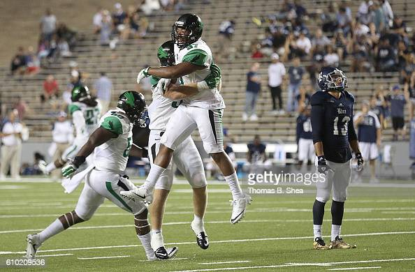 Linebacker Brandon Garner of the North Texas Mean and teammates celebrate defeating the Rice Owls in double overtime at Rice Stadium on September 24...