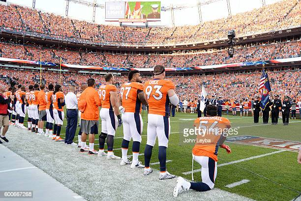 Linebacker Brandon Marshall of the Denver Broncos takes a knee during the national anthem before the first quarter The Denver Broncos hosted the...