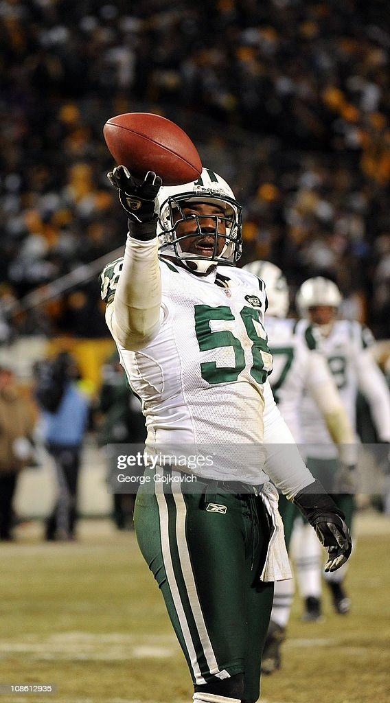 Linebacker Bryan Thomas of the New York Jets holds the football during the 2011 AFC Championship game against the Pittsburgh Steelers at Heinz Field...