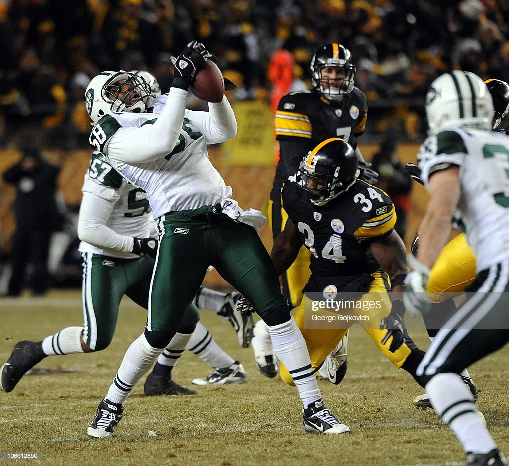 Linebacker Bryan Thomas of the New York Jets intercepts a pass intended for running back Rashard Mendenhall of the Pittsburgh Steelers during the...