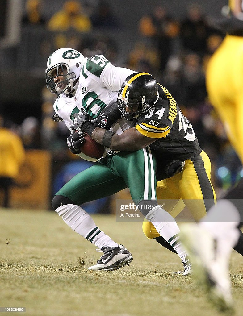Linebacker Bryan Thomas of the New York Jets makes an Interception against the Pittsburgh Steelers during the AFC Championship Game at Heinz Field on...