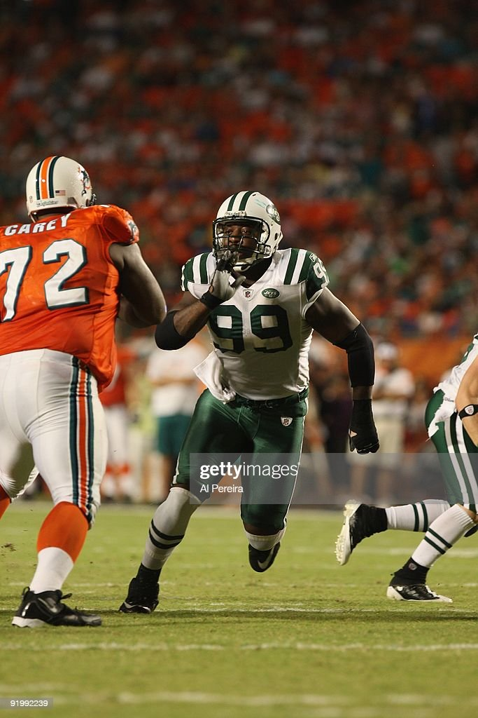 Linebacker Bryan Thomas of the New York Jets rushes the line against the Miami Dolphins at Land Shark Stadium on October 12 2009 in Miami FloridaThe...