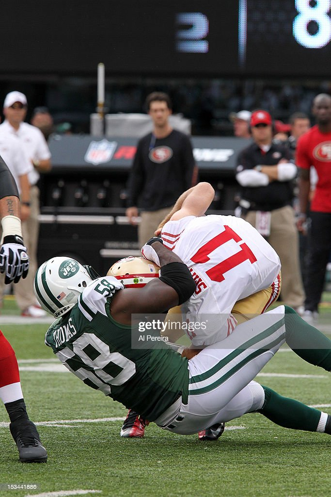Linebacker Bryan Thomas of the New York Jets Sacks Quarterback Alex Smith of the San Francisco 49ers at MetLife Stadium on September 30 2012 in East...