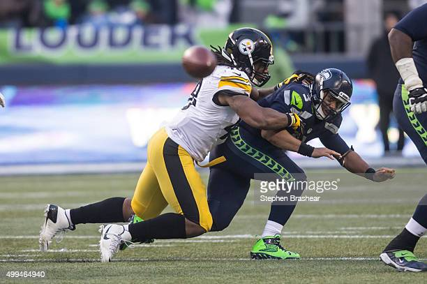 Linebacker Bud Dupree of the Pittsburgh Steelers hits quarterback Russell Wilson of the Seattle Seahawks after Wilson threw the ball during a...