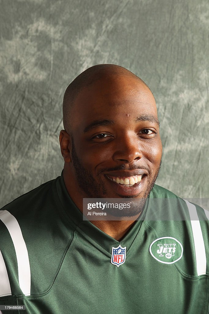 Linebacker <a gi-track='captionPersonalityLinkClicked' href=/galleries/search?phrase=Calvin+Pace&family=editorial&specificpeople=773024 ng-click='$event.stopPropagation()'>Calvin Pace</a> #97 of the New York Jets poses during a portrait session on September 1, 2013 in Florham Park, New Jersey.