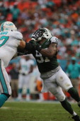 Linebacker Calvin Pace of the New York Jets rushes the Quarterback against the Miami Dolphins at Sun Life Stadium on December 29 2013 in Miami...