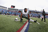 Linebacker Calvin Pace of the New York Jets stretches before the game against the Buffalo Bills at Ralph Wilson Stadium on January 3 2016 in Orchard...