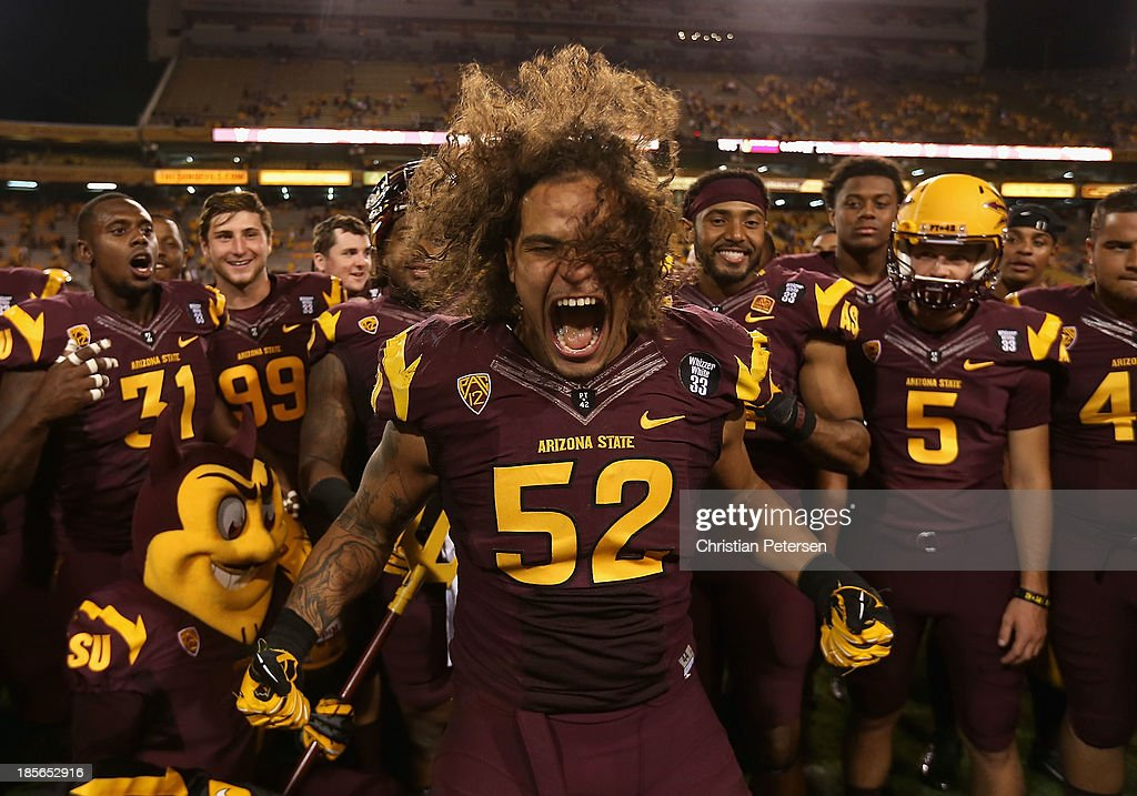 Linebacker Carl Bradford #52 of the Arizona State Sun Devils celerbrates with teammates following the college football game against the Washington Huskies at Sun Devil Stadium on October 19, 2013 in Tempe, Arizona. The Sun Devils defeated the Huskies 53-24.