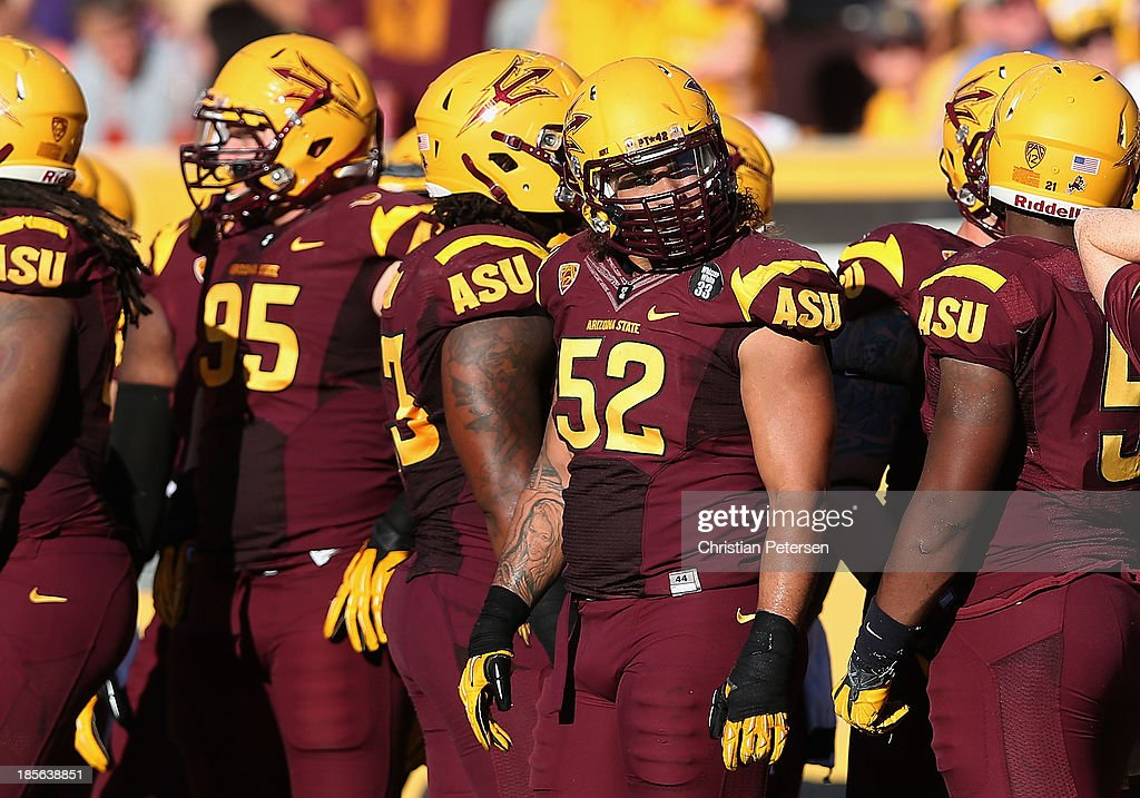 Linebacker Carl Bradford #52 of the Arizona State Sun Devils watches from the sidelines during the college football game against the Washington Huskies at Sun Devil Stadium on October 19, 2013 in Tempe, Arizona. The Sun Devils defeated the Huskies 53-24.