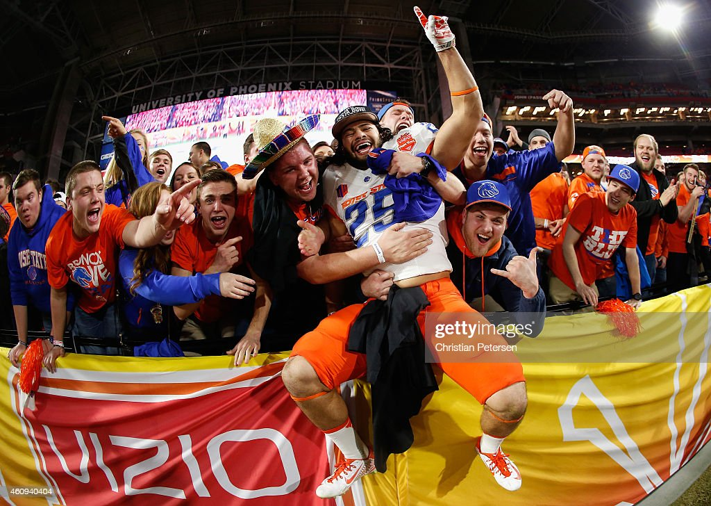 Linebacker Christopher Santini #25 of the Boise State Broncos celebrates with fans after defeating the Arizona Wildcats 38-30 to win the Vizio Fiesta Bowl at University of Phoenix Stadium on December 31, 2014 in Glendale, Arizona.