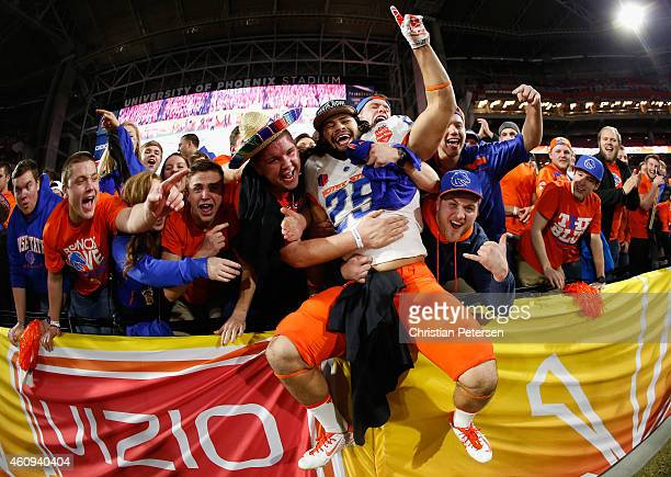 Linebacker Christopher Santini of the Boise State Broncos celebrates with fans after defeating the Arizona Wildcats 3830 to win the Vizio Fiesta Bowl...