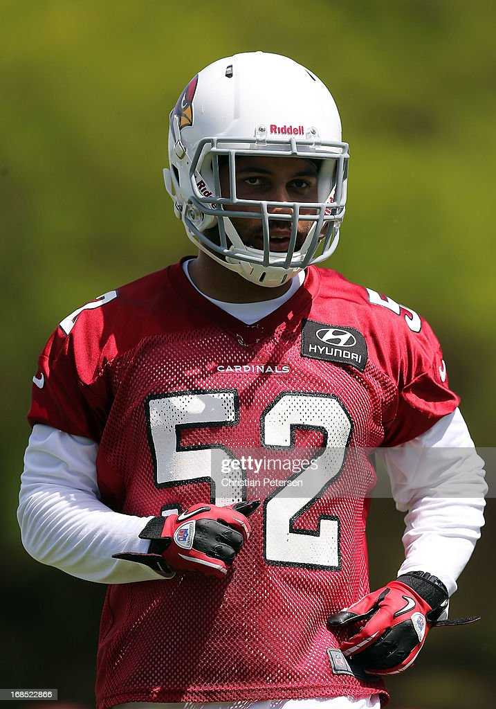 Linebacker Colin Parker #52 of the Arizona Cardinals practices at the team's training center facility on May 10, 2013 in Tempe, Arizona.