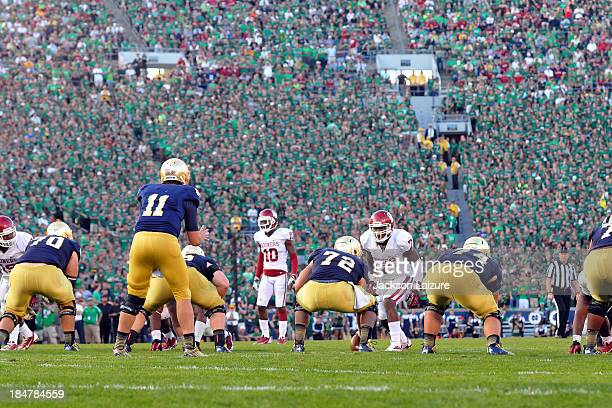 Linebacker Corey Nelson of the Oklahoma Sooners eyes quarterback Tommy Rees of the Notre Dame Fighting Irish during their Wear Green Game on...