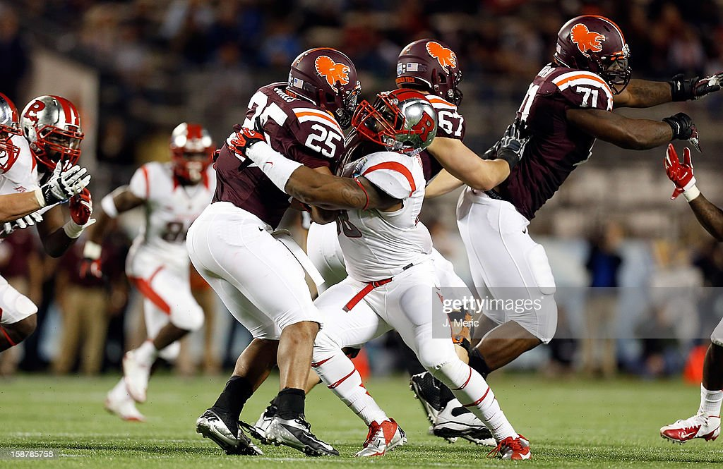 Linebacker Dallas Whitaker #48 of the Rutgers Scarlet Knights tackes running back Martin Scales #25 of the Virginia Tech Hokies during the Russell Athletic Bowl Game at the Florida Citrus Bowl on December 28, 2012 in Orlando, Florida.