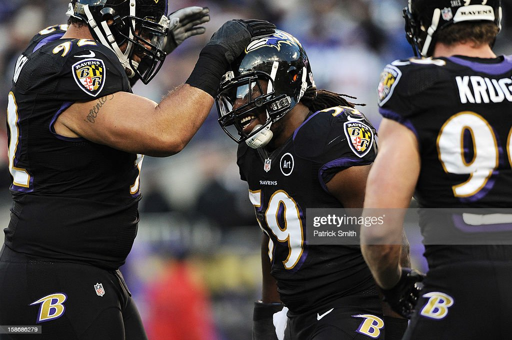 Linebacker Dannell Ellerbe #59 of the Baltimore Ravens celebrates with teammate nose tackle Haloti Ngata #92 after pulling down quarterback Eli Manning #10 of the New York Giants (not pictured) in the first quarter at M&T Bank Stadium on December 23, 2012 in Baltimore, Maryland.