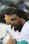 Linebacker Dannell Ellerbe of the Miami Dolphins follows the action against the New York Jets at MetLife Stadium on December 1 2013 in East...