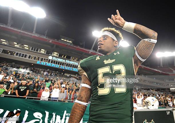 Linebacker Danny Thomas of the South Florida Bulls celebrates on the bench late in the fourth quarter against the Temple Owls at Raymond James...