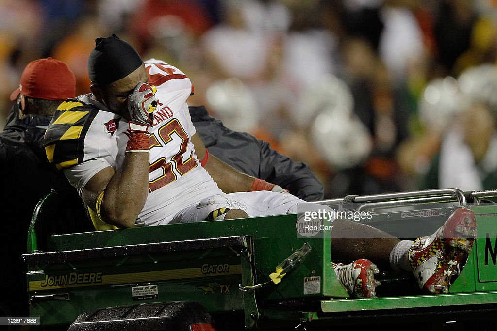 Linebacker Darin Drakeford #52 of the Maryland Terrapins is carted off the field after getting injured against the Miami Hurricanes during the second half at Byrd Stadium on September 5, 2011 in College Park, Maryland. Maryland won 32-24.