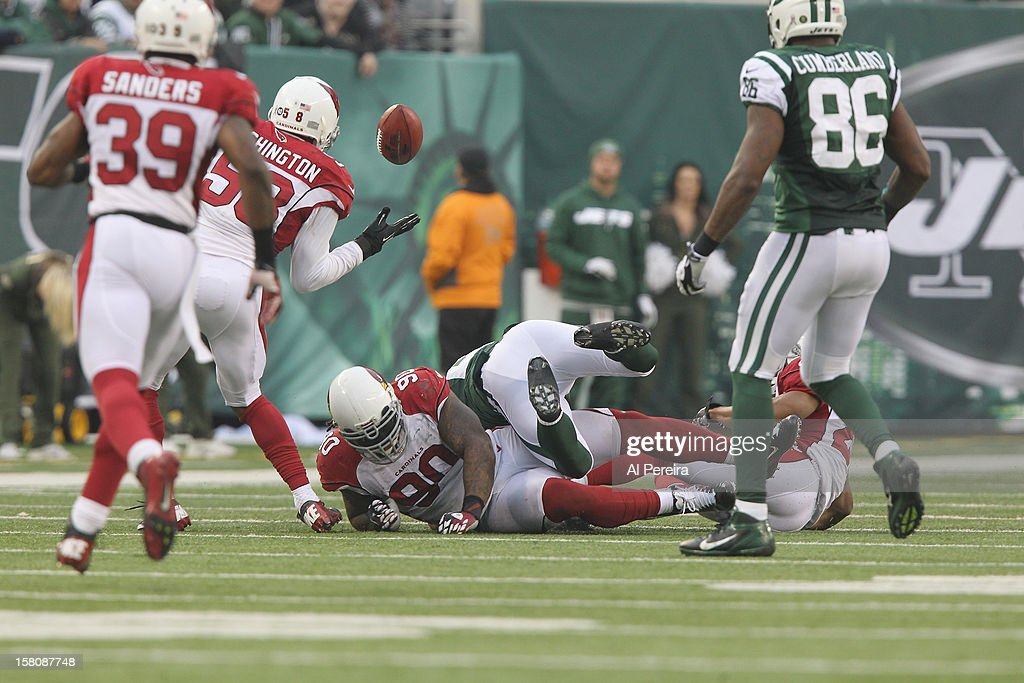 307ee28af ... Linebacker Daryl Washington 58 of the Arizona Cardinals grabs a fumble  by Running Back Kahlil ...