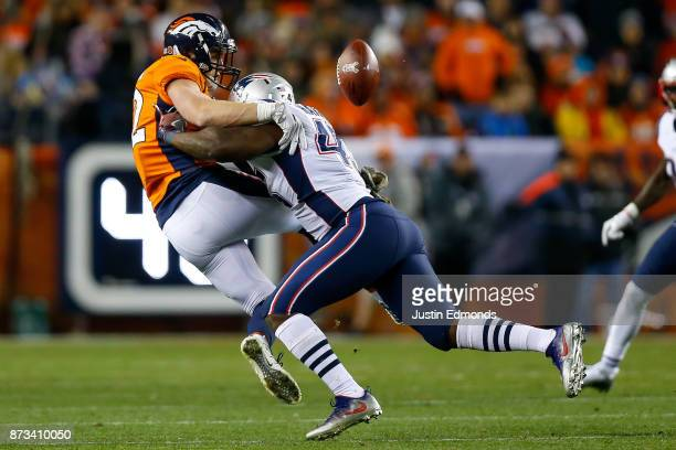 Linebacker David Harris of the New England Patriots breaks up a pass intended for tight end Jeff Heuerman of the Denver Broncos at Sports Authority...