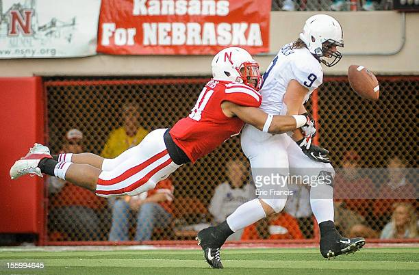 Linebacker David Santos of the Nebraska Cornhuskers breaks up a pass intended for running back Michael Zordich of the Penn State Nittany Lions during...
