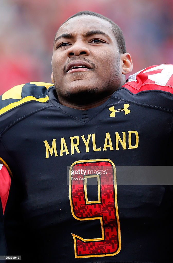 Linebacker Demetrius Hartsfield #9 of the Maryland Terrapins is helped off the field after being injuried against the Georgia Tech Yellow Jackets at Byrd Stadium on November 3, 2012 in College Park, Maryland.