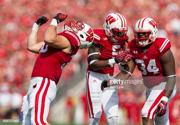 Linebacker Derek Landisch of the Wisconsin Badgers celebrates a tackle against the South Florida Bulls during the third quarter on September 27 2014...