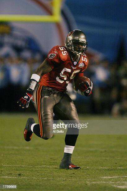 Linebacker Derrick Brooks of the Tampa Bay Buccaneers picks up a fumble by Oakland Raiders quarterback Rich Gannon and runs it in for a fourth...