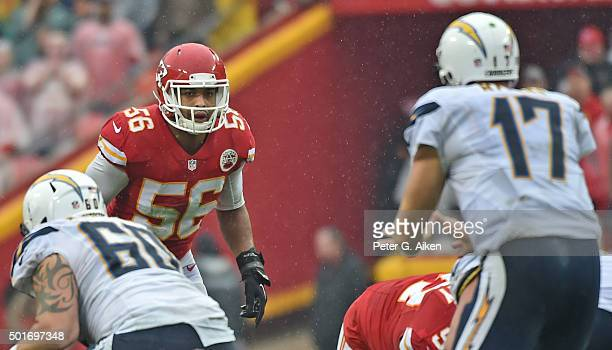 Linebacker Derrick Johnson of the Kansas City Chiefs looks across the line at quarterback Philip Rivers of the San Diego Chargers during the second...