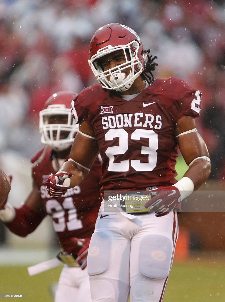 Linebacker Devante Bond #23 of the Oklahoma Sooners celebrates a play against the Kansas Jayhawks November 22, 2014 at Gaylord Family-Oklahoma Memorial Stadium in Norman, Oklahoma. The Sooners defeated the Jayhawks 44-7.