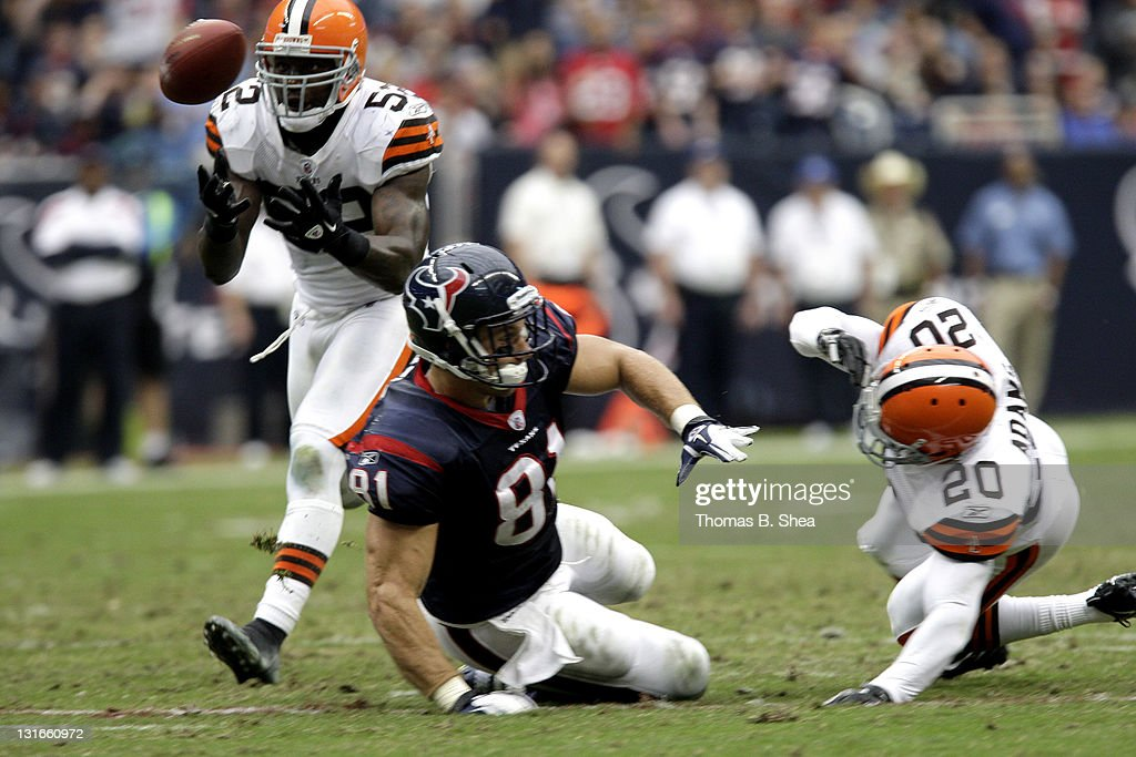 Linebacker <a gi-track='captionPersonalityLinkClicked' href=/galleries/search?phrase=D%27Qwell+Jackson&family=editorial&specificpeople=648560 ng-click='$event.stopPropagation()'>D'Qwell Jackson</a> #52 of the Cleveland Browns intercepts the ball against tight end Owen Daniles #81 of the Houston Texans on November 6, 2011 at Reliant Stadium in Houston, Texas.
