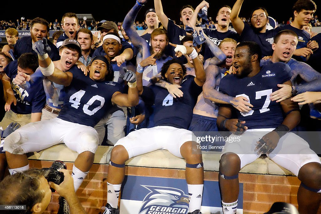 Linebacker Edwin Jackson quarterback Kevin Ellison and linebacker Antwione Williams of the Georgia Southern Eagles celebrate with the student section...